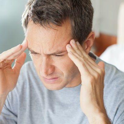 PROD-Man-with-headache-rubbing-forehead