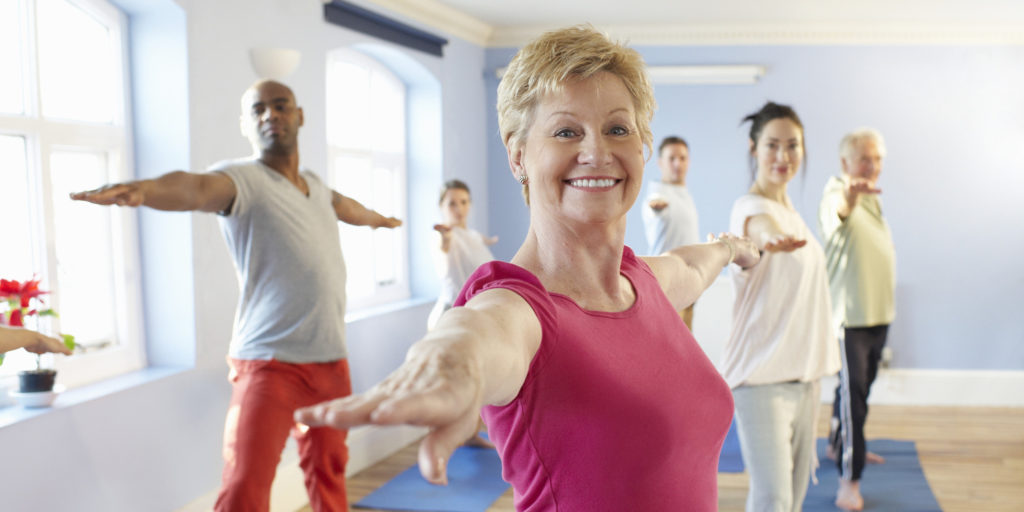 Mature woman at front of exercise class